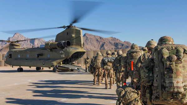 Soldiers attached to the 101st Resolute Support Sustainment Brigade, Iowa National Guard and 10th Mountain, 2-14 Infantry Battalion, load onto a Chinook helicopter to head out on a mission in Afghanistan